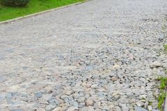 Cobblestone is a natural building material based on cobble-sized stones, and is used for pavement roads, streets, and buildings. 