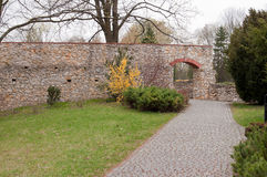 Cobblestone path with an archway Royalty Free Stock Image