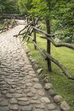 Cobblestone path with fence Stock Image