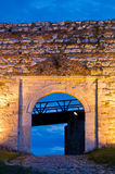 Cobblestone path, fortress gate, and a wooden bridge at twilight  inside Kalemegdan fortress in Belgrade Stock Photos