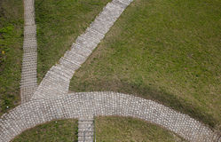 Cobblestone path in grass Royalty Free Stock Photos