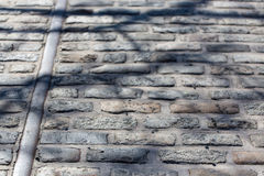 Cobblestone path. Old railway on cobblestone path in Baltimore's Fells Point Royalty Free Stock Images
