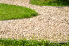 Cobblestone paths. A cobblestone paths and lawns Stock Images