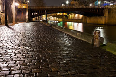 Quay in Paris at night Royalty Free Stock Photo