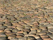 Cobblestone pavement. In the medieval city Royalty Free Stock Photo