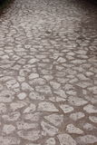 Cobblestone pavement in the Appian way of Rome Stock Image