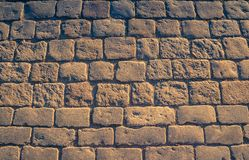 Cobblestone pavement background with copy space, close-up textur royalty free stock image