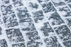 Cobblestone pavement covered with snow and ice Stock Images