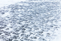 Cobblestone pavement covered with snow and ice. Sidewalk Cobblestone pavement covered with snow and ice stock images