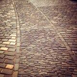 Cobblestone pavement of Edinburgh castle - vintage effect. Old paving useful as a background - retro filter. Abstract brick pavement. Edinburgh, Scotland stock photography