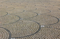 Cobblestone pavement with fish scale pattern Stock Photo