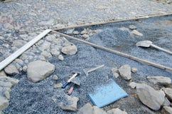 Cobblestone pavement installation Stock Photos