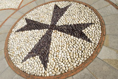 Cobblestone pavement mosaic in the shape of a cross Stock Photos