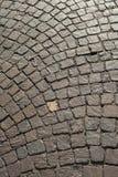 Cobblestone pavement pattern stock images