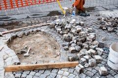 Cobblestone pavement repairing Stock Photo