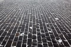 Cobblestone pavement with snow. Close up cobblestone pavement in winter time Stock Photos