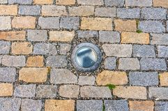 Cobblestone pavement on street with lighting Royalty Free Stock Photography