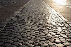 Cobblestone pavement at sunset Royalty Free Stock Images