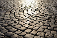 Cobblestone pavement at sunset Stock Photography