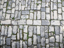 Cobblestone pavement to use as background or wallpaper Royalty Free Stock Image