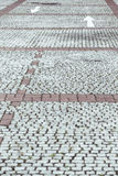 Cobblestone pavement with white arrows Stock Image