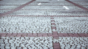 Cobblestone pavement with white arrows Royalty Free Stock Image