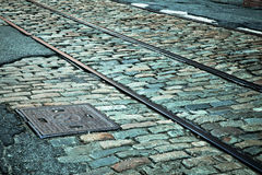 Cobblestone and rails Royalty Free Stock Photos