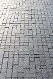 Cobblestone with reflection. Sunshine of street cobblestone pavement background Royalty Free Stock Photos