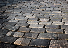 Cobblestone road Stock Images
