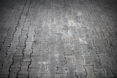 Cobblestone road. Background texture of gray cobblestone road Royalty Free Stock Photo