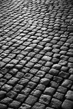 Cobblestone Road. Background image of old cobblestone road back-lit with low sunlight Royalty Free Stock Photography