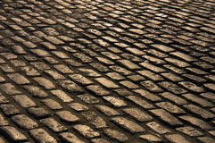 Cobblestone Road. An ancient cobblestone road. Sepia toned for a vintage look stock image