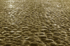 Cobblestone road background Stock Photos