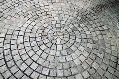 A cobblestone road - circle pattern Royalty Free Stock Photos