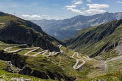 Panoramic view of the road tremola in Airolo, Ticino. Sunny day with clouds royalty free stock image