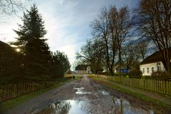 Cobblestone road and historical manor, listed as monument in Dargelin, Mecklenburg-Vorpommern, Germany.  Royalty Free Stock Photo