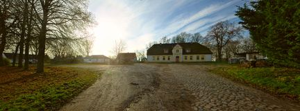 Cobblestone road and historical manor, listed as monument in Dargelin, Mecklenburg-Vorpommern, Germany.  Stock Photo