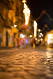 Cobblestone road at night Royalty Free Stock Photo