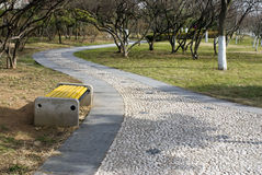 Cobblestone road park path Stock Photos