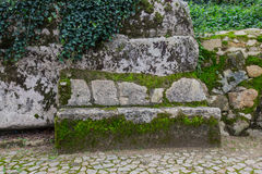 Cobblestone road to the palace foam among the rocks and trees an Royalty Free Stock Photos