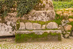Cobblestone road to the palace foam among the rocks and trees an Stock Photos