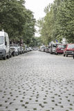 Cobblestone Road With Cars Royalty Free Stock Image