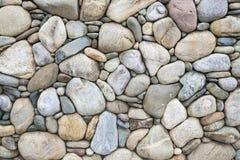 Cobblestone rock wall Stock Photography