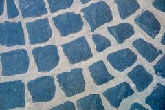 Cobblestone or sett background. Dark grey urban road. Texture. Royalty Free Stock Photography