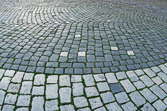 Cobblestone sidewalk made of cubic stones 2 Stock Images