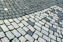 Cobblestone sidewalk made of cubic stones 3 Royalty Free Stock Images
