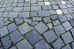 Cobblestone sidewalk made of cubic stones 10 Royalty Free Stock Photos