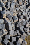 Cobblestone stored at a construction site Stock Photos