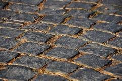 Cobblestone street detail. Closeup photo of a texture - cobblestone street detail royalty free stock image