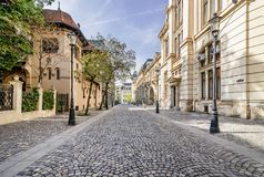 Lipscani in the center of Bucharest, Romania. Cobblestone street in Lipscani area in the historical center of Bucharest, Romania, Europe royalty free stock photos